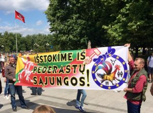 "Counterprotestors suggest ""Leaving the Pederast Union"" at Baltic Pride 2016 in Vilnius, Lithuania. Photo: Auris Jarasunas"